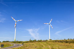 Windmills gather energy from the summer breeze. Stock Images