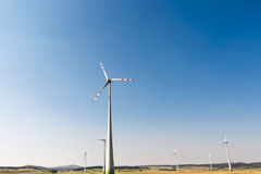 Windmills generating clean electricity. Ecology, prevention of global warming royalty free stock photos