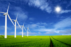 Windmills in a green field Stock Photo