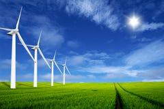 Windmills in a green field Stock Photo