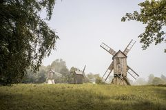 Windmills in green field. Beautiful landscape view of windmills in green field Stock Photo