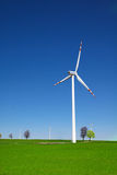 Windmills on the green grass Stock Photography