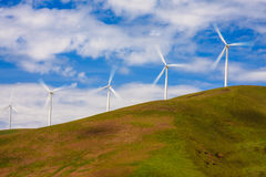 Windmills on a Green Hill Stock Image