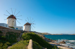 Windmills on a green hillside near the sea Royalty Free Stock Photography