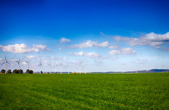 Windmills on Green Meadow. Ecological Resource Royalty Free Stock Images