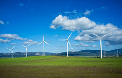 Windmills on green meadow. Spain Royalty Free Stock Photo