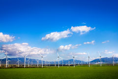 Windmills on green meadow. Spain Royalty Free Stock Photos