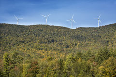 Windmills on a high ridge against a blue sky, Maine. Royalty Free Stock Photo