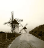 Windmills on hill. Traditional windmills on hill, sepia tone Royalty Free Stock Photo