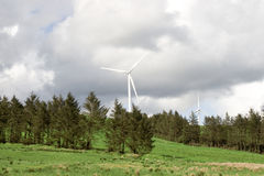 Scenic view of windmills in green Irish countryside Royalty Free Stock Image