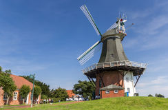 Windmills in the historic center of Greetsiel Stock Photos