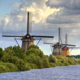 Windmills in Holland. Vegetation and clouds Royalty Free Stock Images