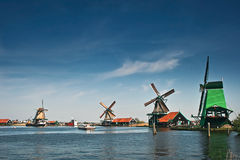 Windmills in Holland. On the shore on sunny day Royalty Free Stock Photos
