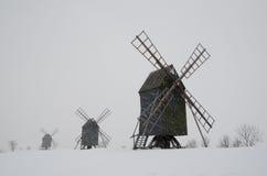Windmills i snowfall royaltyfri foto