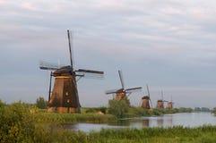 Windmills In Evening Sun Stock Photo