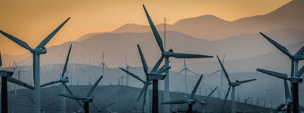 Windmills IV. Windmills in Palm Springs, CA at sunset Royalty Free Stock Images