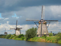 Windmills Kinderdijk. Windmills of Kinderdijk in typical dutch weather, Netherlands, UNESCO World Heritage Site Stock Photos