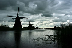 Windmills at Kinderdijk. A row of Windmills at Kinderdijk, the Netherlands, during the onset of a storm Royalty Free Stock Photos