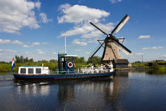 Windmills at Kinderdijk. Traditional Dutch windmills at world famous Kinderdijk on a beautiful Summer afternoon Royalty Free Stock Photo