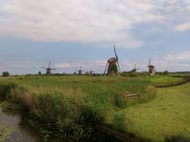 Windmills in Kinderdijk. Dutch windmills in Kinderdijk which are on UNESCO List Royalty Free Stock Photo