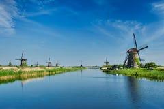 Windmills at Kinderdijk in Holland. Netherlands. Netherlands rural lanscape with windmills at famous tourist site Kinderdijk in Holland royalty free stock image
