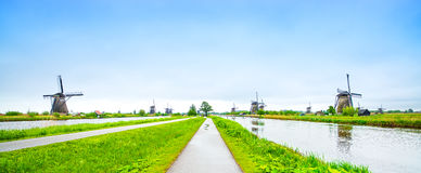 Windmills in Kinderdijk, Holland or Netherlands. Windmills and water canal in Kinderdijk, Holland or Netherlands, panoramic view. Unesco world heritage site Royalty Free Stock Images
