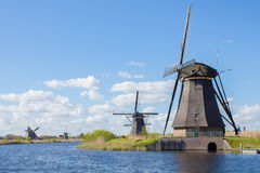 Windmills in Kinderdijk, Holland. A water channel and historical windmills in Kinderdijk, Holland royalty free stock images