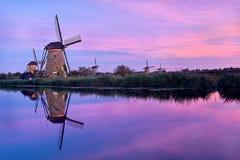 Windmills At Kinderdijk. Windmills and reflection at sunset in Kinderdijk, Netherlands Stock Images
