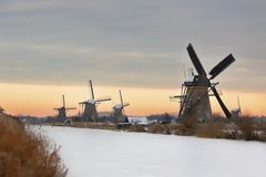 Windmills in Kinderdijk at winter sunset Stock Photo