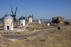 Windmills - La Mancha - Spain. The windmills and castle of Consuegra in the La Mancha region of central Spain Royalty Free Stock Image