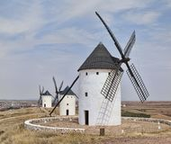 Windmills in line at Alcazar de San Juan stock photo