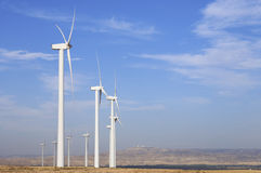 Windmills lined Stock Photography