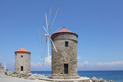 Windmills on the Mandraki harbor of Rhodes Royalty Free Stock Image