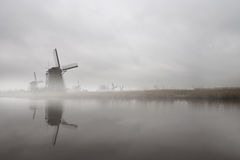 Windmills in the mist Stock Images