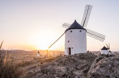 Windmills in Consuegra, Toledo Province, Castilla La Mancha, Spa. Windmills molinos in Consuegra, Toledo Province, Castilla La Mancha, Spain, at sunset Royalty Free Stock Images