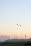 Windmills in morning mist Royalty Free Stock Photos