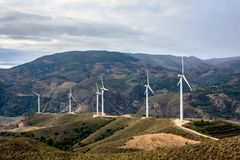 Windmills in the mountains. Construction of new windmills in the mountains of Las Alpujarras in the neighborhood  of Orgiva, Spain Royalty Free Stock Photos