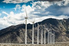 Windmills. With mountns and a cloudy sky background Stock Image