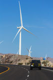 Windmills near highway Royalty Free Stock Image