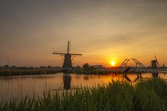 Windmills during sunset in the Netherlands royalty free stock photos