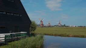 Windmills in the Netherlands - typical view in Holland - Amsterdam - The Netherlands - July 19, 2017 stock footage