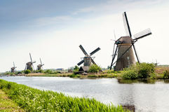 Windmills next to a channel in Kinderdijk, The Netherlands Royalty Free Stock Image