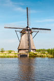 Windmills next to a channel in Kinderdijk, The Netherlands Stock Image