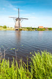 Windmills next to a channel in Kinderdijk, The Netherlands Stock Images
