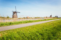 Windmills next to a channel in Kinderdijk, The Netherlands Royalty Free Stock Photos