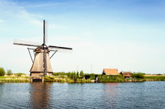 Windmills next to a channel in Kinderdijk, The Netherlands Royalty Free Stock Images