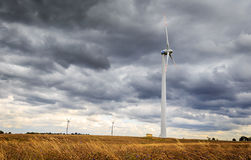 Windmills in Niechorze. Windmills against the cloudy sky. Wind turbines on the meadow Stock Images