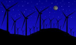 Windmills at night Stock Photos