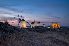 Windmills at the night in Consuegra town in Spain Stock Image