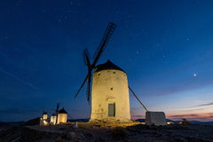 Windmills at the night in Consuegra town in Spain Stock Images